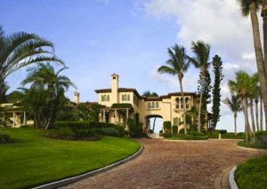 beautiful front view of luxury oceanfront estate located at 12210 Banyan Road, palm beach